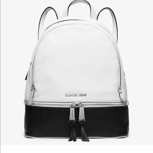 a405a5a4bb46 Michael Kors Rhea Colorblock Leather Backpack. M 5ba78e32a31c33ef0a40acd8